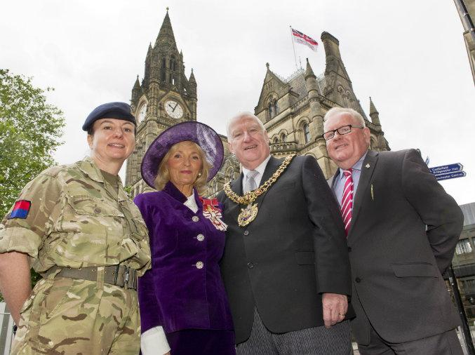 The Armed Forces Flag flys above Manchester Town Hall